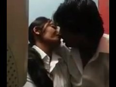 desi couple intimate moment in cafe